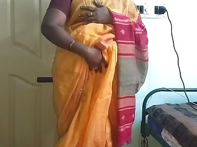 desi  indian horny tamil telugu kannada malayalam hindi cheating wife vanitha wearing orange colour saree  showing big boobs and shaved pussy press hard boobs press nip rubbing pussy masturbation